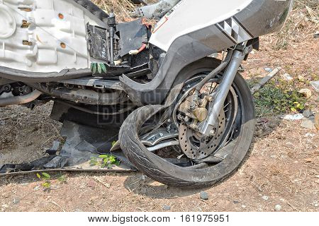 Motorcycle front wheel was demolished from the accident.
