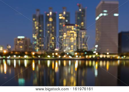 Night blurred lights city building with reflection, abstract background