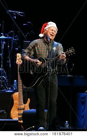 BROOKLYN, NY-DEC 9: Jimmy Buffett performs at WCBS-FM 101.1's Holiday in Brooklyn at Barclays Center on December 9, 2016 in Brooklyn, New York.