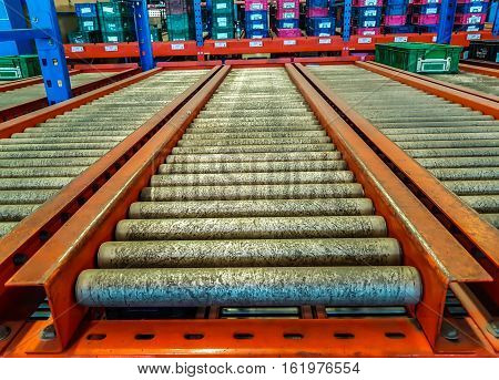 The conveyor rollers in distribution warehouse or storehouse