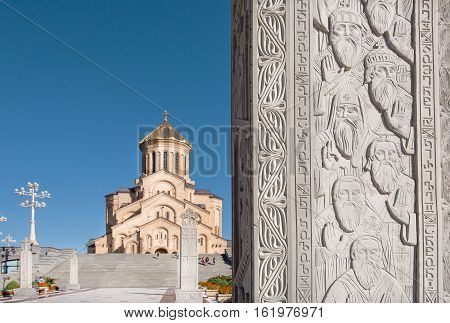 TBILISI, GEORGIA - SEP 27, 2016: Priets and monks on relief of stone column near the Holy Trinity Cathedral on September 27, 2016. The Orthodox cathedral was built in 2004 with nine chapels and narthex