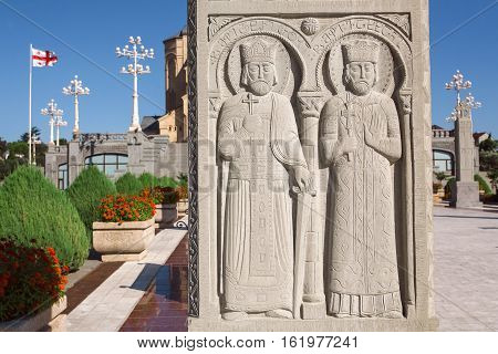 TBILISI, GEORGIA - SEP 27, 2016: Two saints seniors on relief of stone column near Holy Trinity Cathedral on September 27, 2016. The Orthodox cathedral was built in 2004 with 9 chapels and narthex