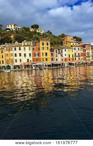 The village of Portofino with the colorful houses and boats in the port. Genova Liguria Italy