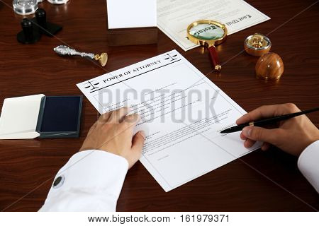 Notary public signing power of attorney in office