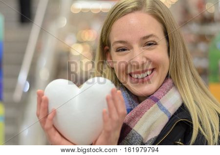 Happy Young Woman Holding A Large White Heart