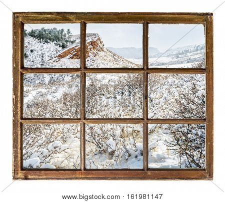 Winter scenery of Colorado foothills  as seen through vintage, grunge, sash window with dirty glass