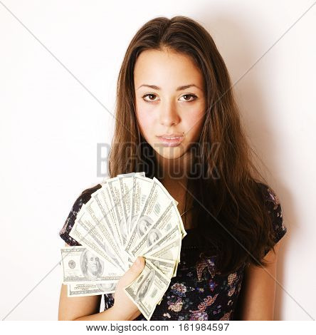 pretty young brunette real modern woman with money cash isolated on white background happy smiling, lifestyle people concept close up