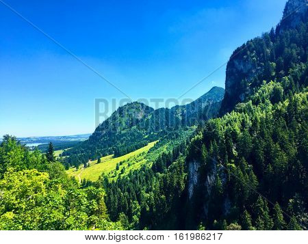 Bavarian mountain landscape in Fussen Germany, close to the famous Neuschwanstein and hohenswangau castles during a summer sunny day,