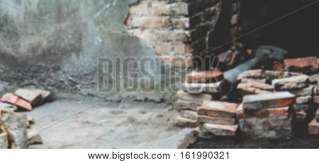 blurred picture of  Broken brick wall background with vintage style,Construction demolish brick fence ruin background template