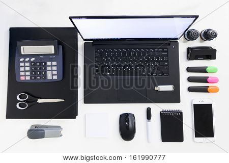 Black and white office supplies with laptop on office supplies desktop. Office supplies concept