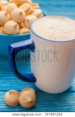 Coffee With Milk And Biscuits In The Bowl And On The Table Near Cup.