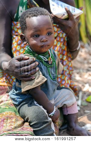 AFRICA, TANZANIA, MAY, 10, 2016 - Portrait of a baby closeup of a Hadza tribe.  Hadzabe tribe threatened by extinction in Tanzania, Africa