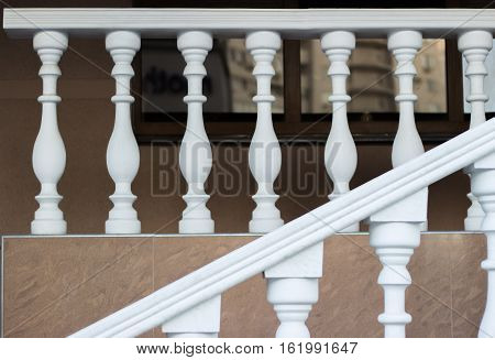 Stairs to the street with white balustrade.