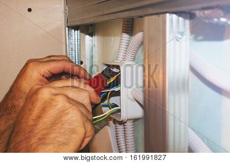 Electricians clears wire for electricity installation. wiring works