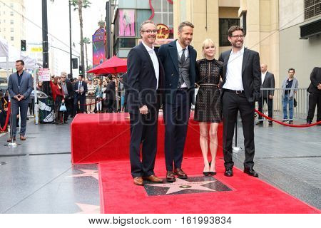 LOS ANGELES - DEC 15: Rhett Reese, Ryan Reynolds, Anna Faris, Paul Wernick at the Ryan Reynolds Hollywood Walk of Fame Star Ceremony at the Hollywood & Highland on December 15, 2016 in Los Angeles, CA