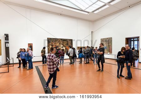 Visitors In Hall With Paintings In Uffizi Gallery
