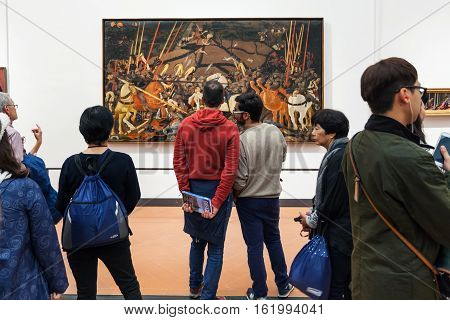People View Painting In Room Of Uffizi Gallery