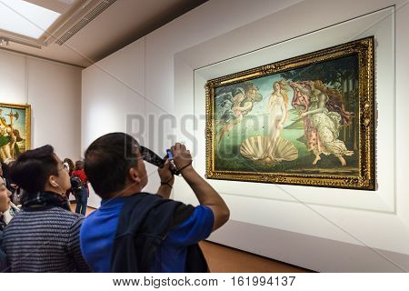 Tourist Takes Photo In Room Of Uffizi Gallery