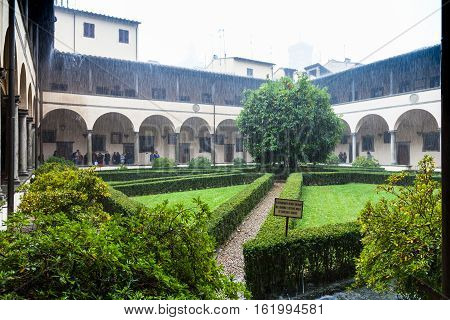 Courtyard Of Basilica Di San Lorenzo In Rain