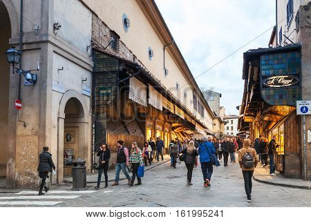 People Walk On Ponte Vecchio In Florence City