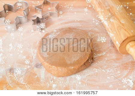 Gingerbread cookie dough, rolling pin, cookie cutters and flour on wooden table. Preparation of gingerbread cookies for Christmas holidays