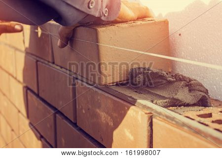 Bricklaying under unravel. construction work. The construction of the house