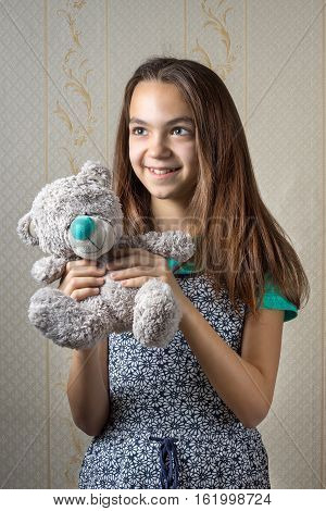 Happy 11 Year Old Girl With A Teddy Bear