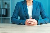 Business negotiation skills with female executive sitting at office desk with confident pose and hands crossed body language for determination and willpower poster