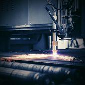 Industrial cnc plasma machine cutting of metal plate poster