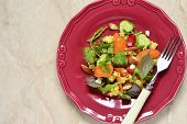Moroccan salad: carrots millet herbs pepper, top view, copy space poster