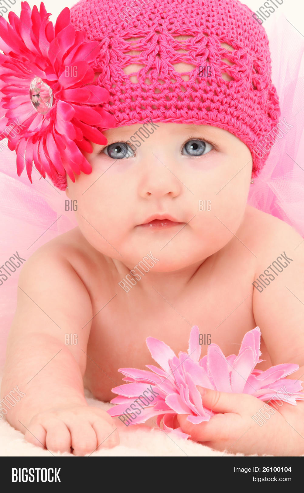 Close up beautiful 4 month old american baby girl in pink flower hat and  tutu. 3edce61b4d1