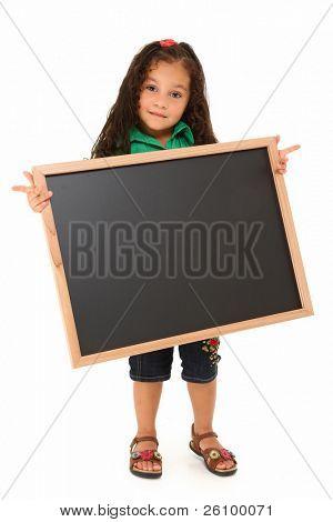 Beautiful three year old hispanic girl with blank chalkboard over white.
