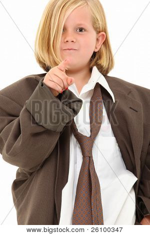 Adorable 7 year old blond american girl in baggy suit pointing angry towards camera over white background.