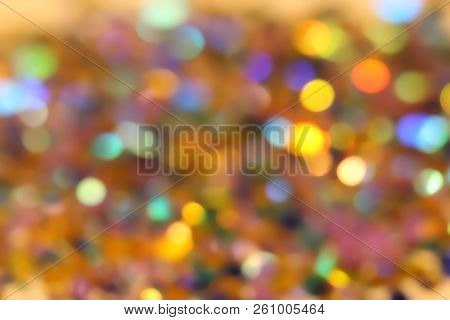 Blurred Abstract Creative Background. Gold And Yellow Background. Lens Flare. Colorful Bokeh Light.