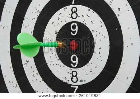 Green Dart In The Center Zone Of Target