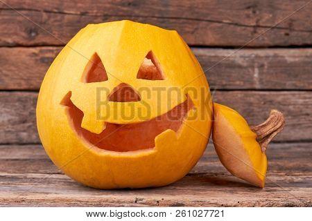 Halloween Pumpkin Head Jack Lantern. Funny Halloween Pumpkin On Wooden Background. Symbol Of Hallowe