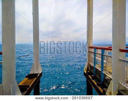 Rusty Metal Pier Support. Attractive View Under The Pier. Perspective Of Metal Rusty Bridge Structur
