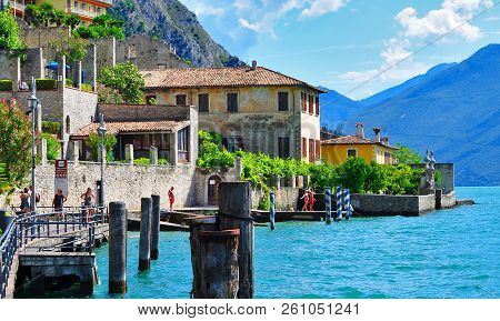 Limone Sul Garda, Italia - May 2014: Beautiful View Of Limone Sul Garda, Of The Embankment And Cafes
