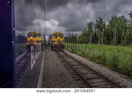 Whittier, Alaska Usa - Aug 15, 2018. Scenic Train Meets Service Train On The Way To Whittier