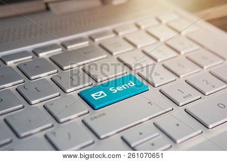 Blue Submit push button on a white keyboard, Color button on the gray silver keyboard of modern ultrabook. caption on the button poster