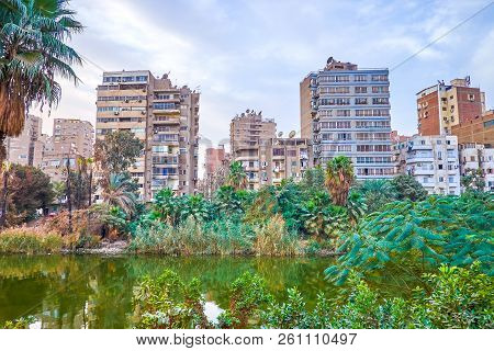 The Old Decrepit Residential Buildings In Roda (rawdah) Island With A View On The Nile Branch, Cairo