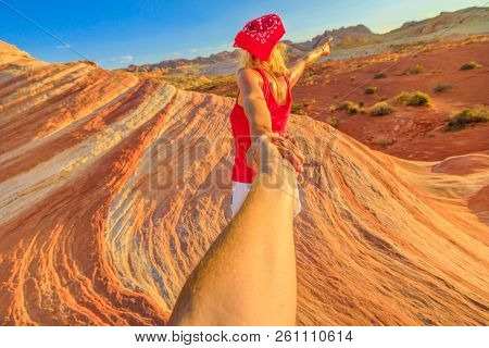 Follow Me, Young Girl Holding Hands At Fire Wave Hike. Sporty Tourist In Valley Of Fire State Park,