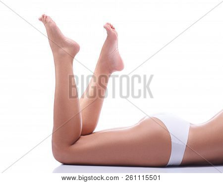 The Legs Of A Young Girl, Part Of The Female Body, Tanned Skin, Body Care, Female Legs Isolated On W