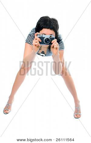 beauty girl photographer in sailor's vest with photo camera on white background