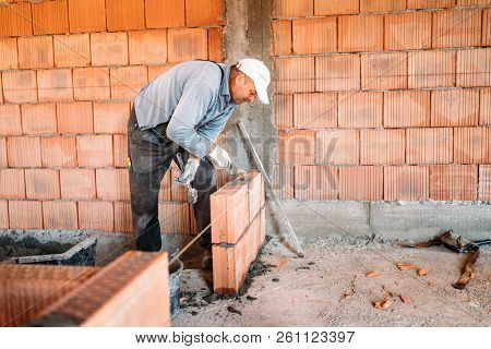 Bricklayer Industrial Worker Installing Brick Masonry On Interior Wall With Trowel Putty Knife