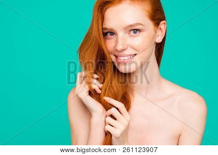 Close-up Portrait Of Nice Nude Positive Sweet Tender Nice Cheerful Red-haired Girl With Shiny Pure C