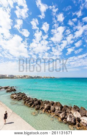 Otranto, Apulia, Italy - A Woman Going Out For A Walk At The Quay Of Otranto