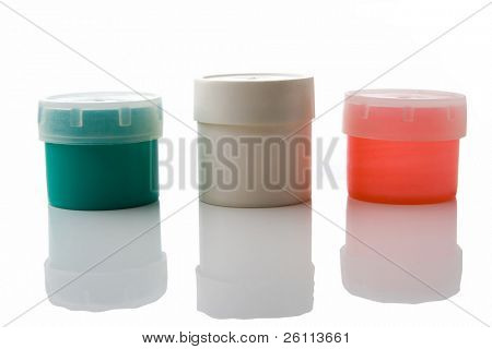 three plastic can over white