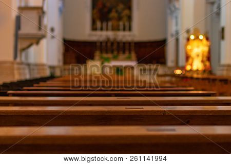 Church Benches In The Empty Catholic Church. Italy