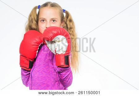 Feminist movement. Self defence concept. Girl boxer knows how defend herself. Girl child strong with boxing gloves posing on white background. She ready to defend herself. Sport upbringing for girls poster